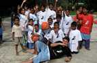Group shot of young people with volunteer Pierre Johannessen in Bangladesh.