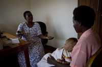 A mother who is hearing-and speech-impaired learns about her legal rights and being healthy in Kawempe, Uganda.