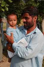 Fathers care for their children in Pakistan as they share roles with women. Photo by Heather Pillans for AusAID
