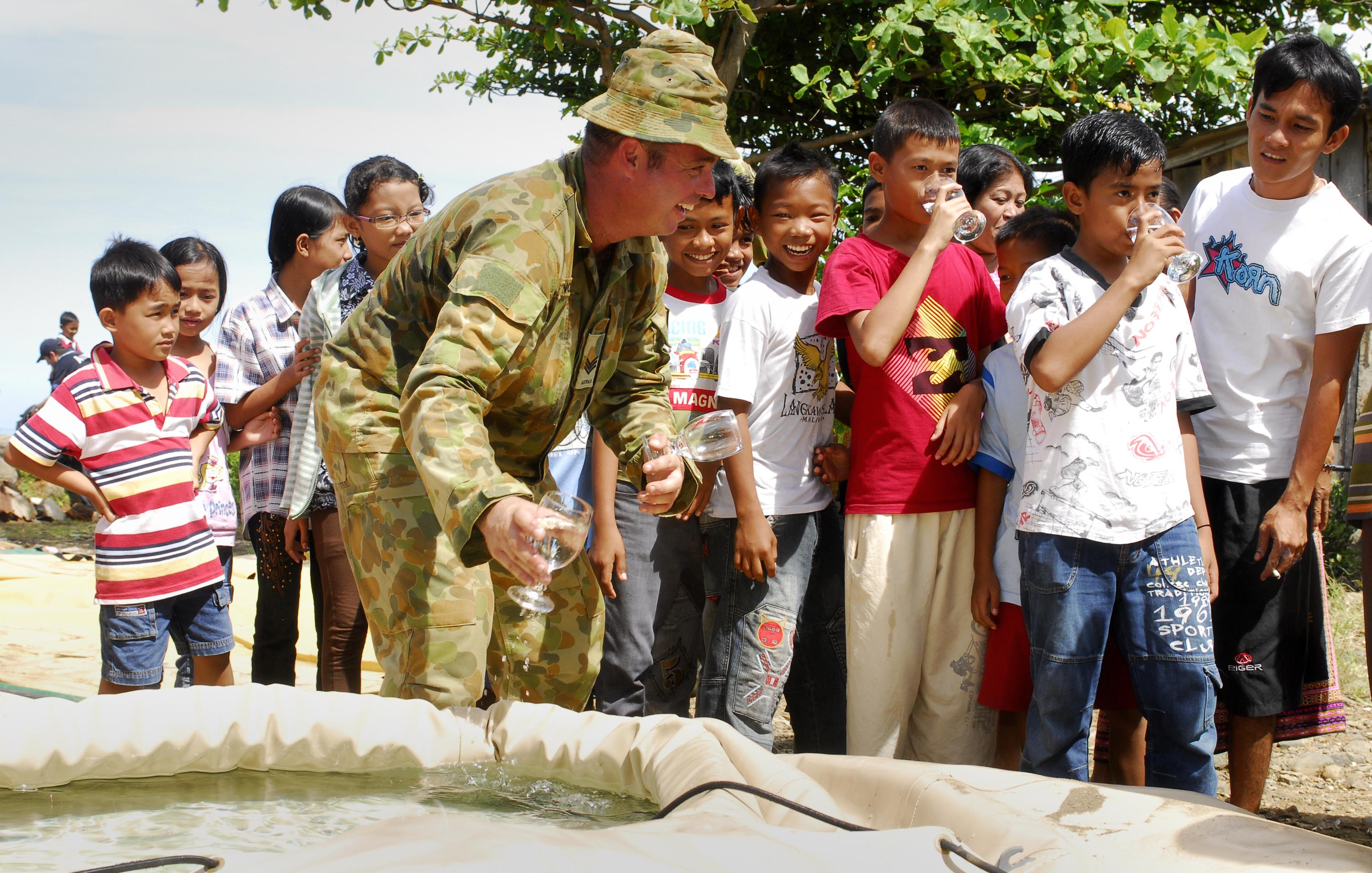International aid provided clean water after villages in Padang, Indonesia were struck by a devastating earthquake. Photo by the Australian Defence Force