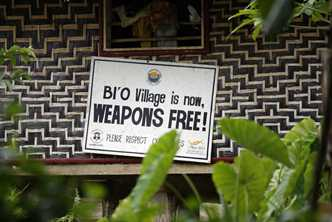 A sign celebrating the removal of weapons is an important part of building a safe environment for peace in Solomon Islands. Photo by Rob Maccoll for AusAID