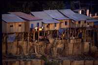 Poor people fear being forced to leave their homes, built along Bassac River in Phnom Penh, Cambodia.