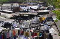 Every day, hundreds of washermen work in the open laundry in Mumbai, India. At night their wash slats become beds.
