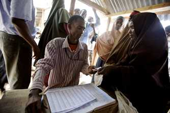 A woman has her ration card checked at the Ifo refugee camp in Dadaab, Kenya. Photo by Kate Holt/Africa Practice