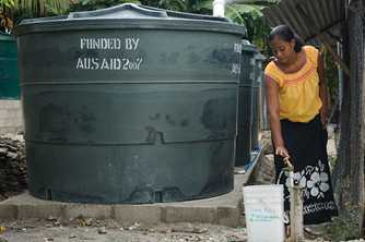 Water tanks provide a clean supply of water for people living in Kiribati. Photo by Lorrie Graham for AusAID