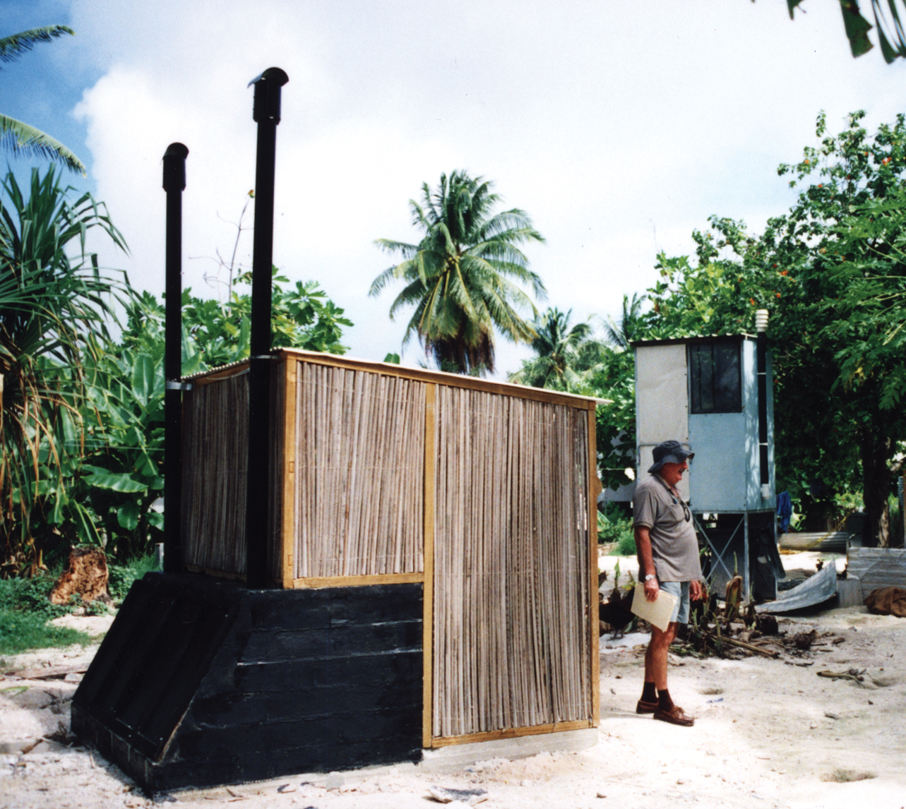 Above-ground compost toilets reduce contamination of underground water by septic tanks and pit latrine toilets, in Kiribati. Photo by John Macklin for AusAID