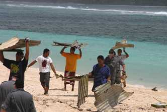 After a tsunami, Samoan volunteers helped clean up the reef. Photo by Lou Anderson for AusAID