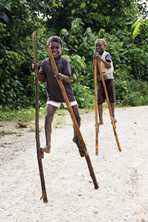 Boys walking on stilts in Solomon Islands. Photo by Rob Maccoll for AusAID
