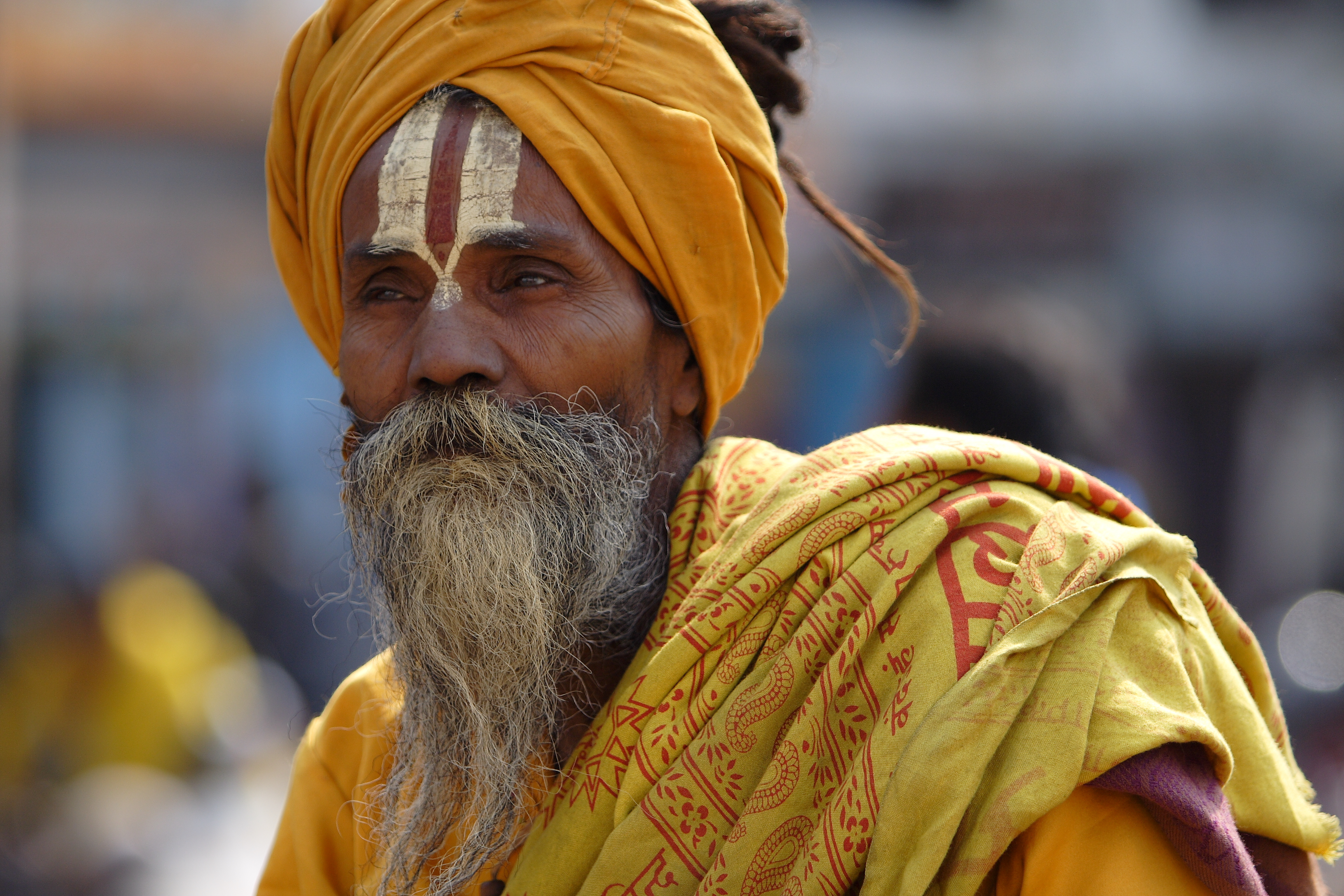 Holy men often wear ochre-coloured clothing to symbolise their focus on holy life and rejection of worldly pastimes. Photo by Dirk Guinan