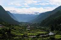 The steep Haa Valley in western Bhutan looks toward the snow-capped Himalayas.