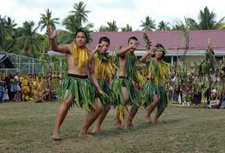 A Niuean dance group performs a traditional Polynesian dance to welcome tourists. Photo by AAP Image/Xavier La Canna