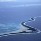 Funafuti Atoll, Tuvalu, 11 kilometres long and 150 metres at its widest, is at risk of being swamped by the sea. Photo © Matthieu Paley/Corbis