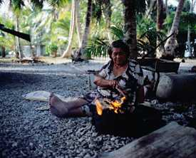 Cooking on Likiep Atoll, Marshall Islands Photo by Christian Aslund/Lonely Planet Images