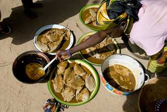 In a Niger village, this feast of lamb, vegetables and millet, which celebrates a child's baptism, is shared among everyone. Photo from World Vision Australia