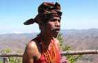A Timor-Leste man wears a tais mane around his waist, made from cloth woven in a local design.