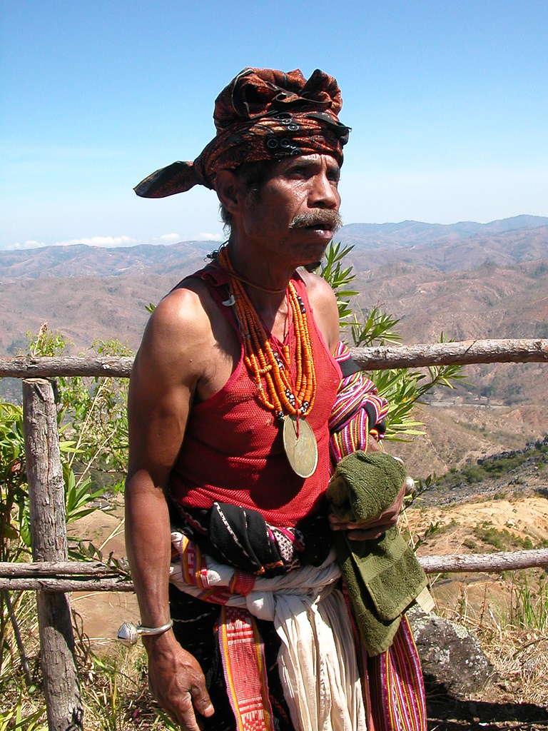 A Timor-Leste man wears a tais mane around his waist, made from cloth woven in a local design. Photo by CpILL / Wikimedia http://creativecommons.org/licenses/by-nc-nd/2.0/