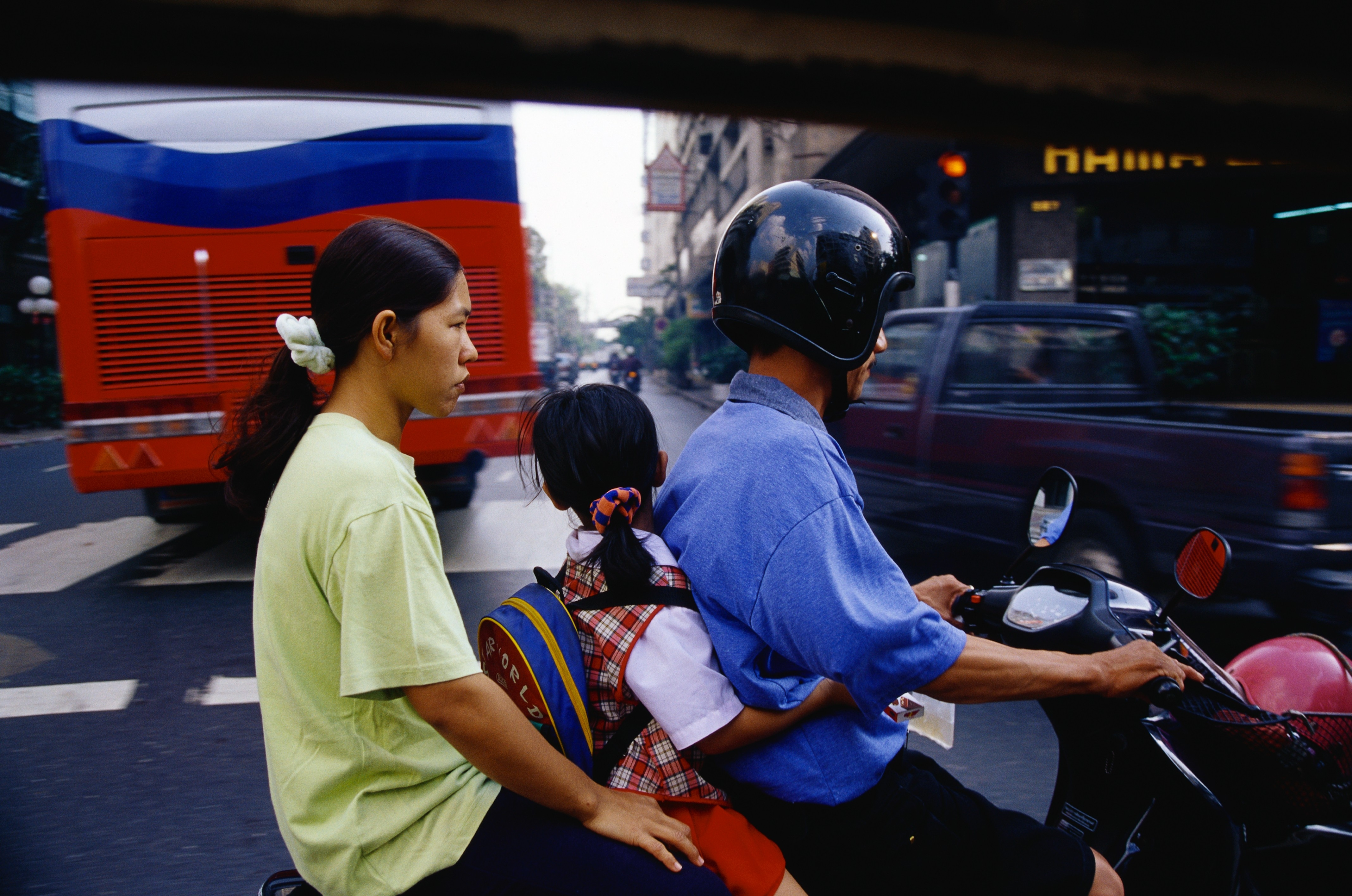 A family riding a motorcycle in Bangkok, Thailand Photo © Macduff Everton/CORBIS