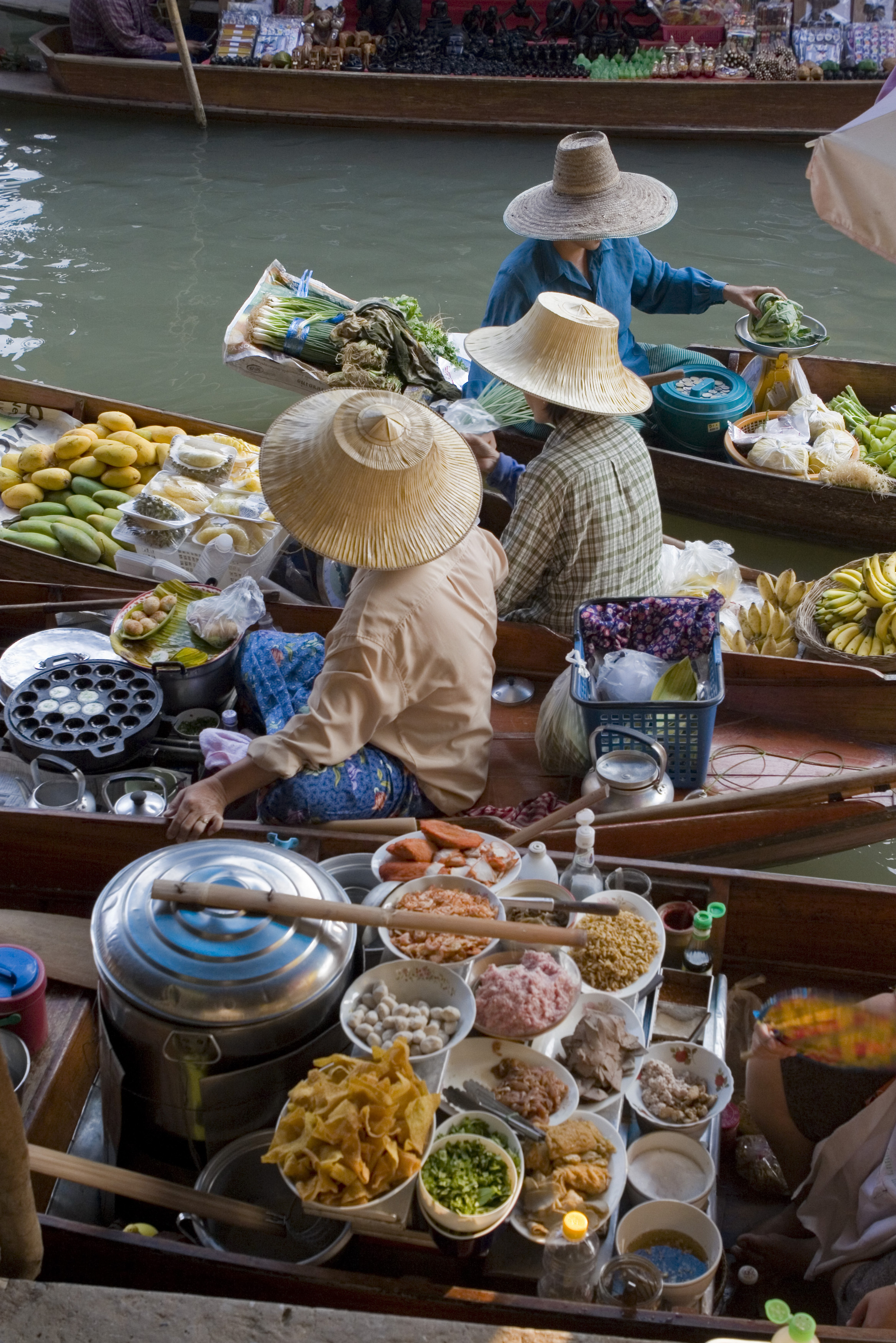 The colourful floating markets in Thailand are where farmers bring their produce to sell from small boats. Photo © Michele Falzone/JAI/Corbis