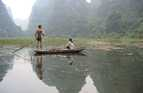 People fishing in Ha Long Bay, north-east Vietnam.