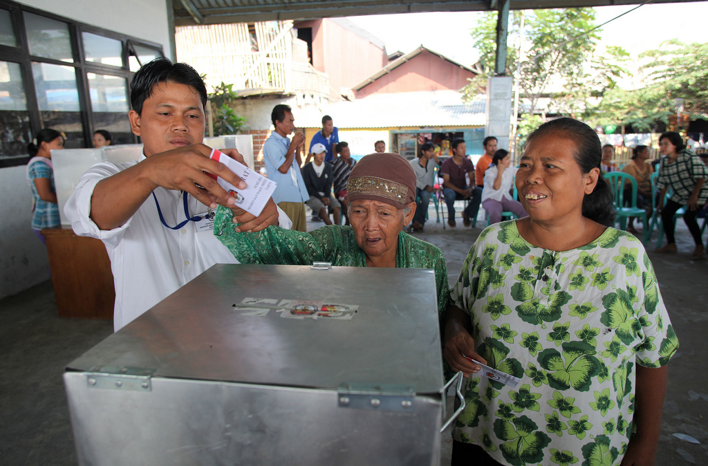 A woman casts her vote in Indonesia's election. Gender equality, including through democratic governance, is a priority for Indonesia's development. Photo by Josh Estey for AusAID