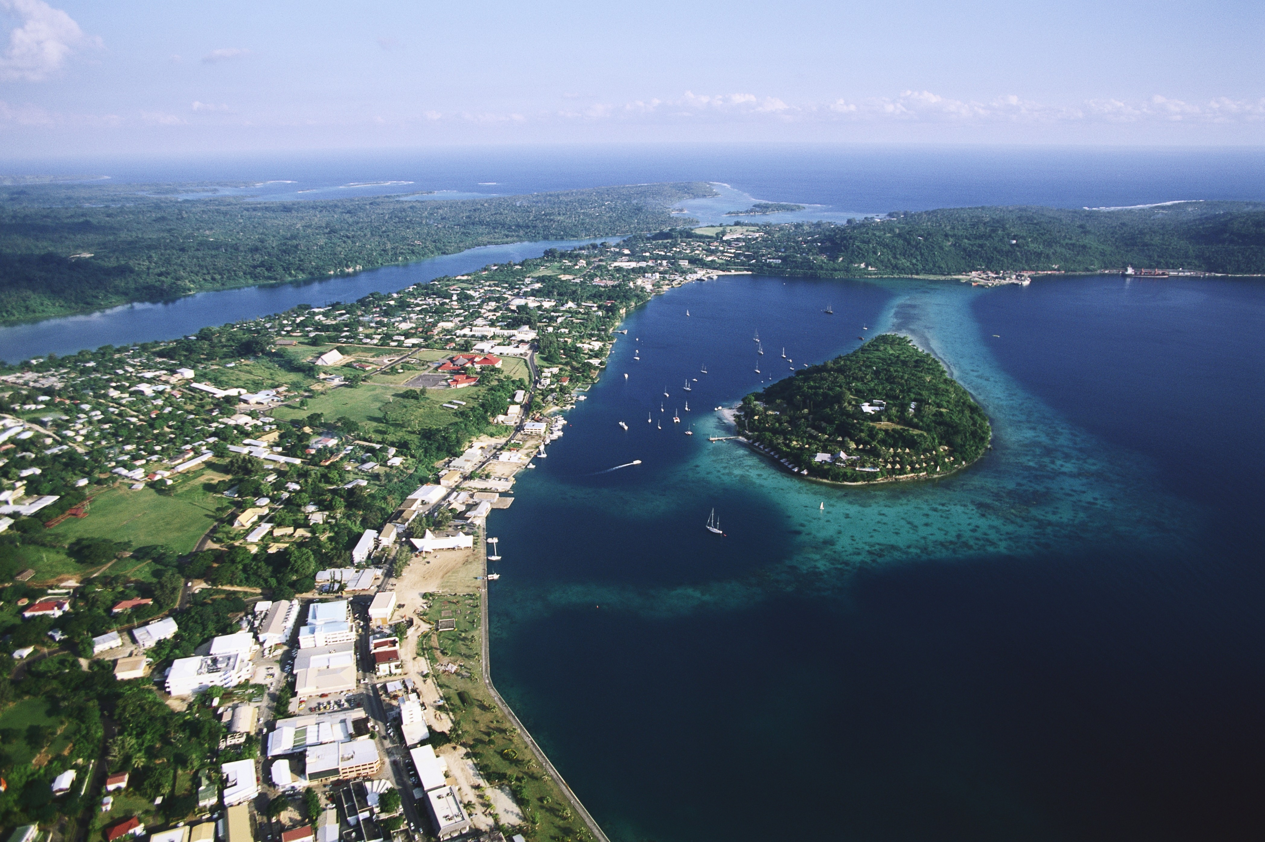 An aerial photograph of Port Vila, the capital of Vanuatu, also shows Iririki Island in Port Vila Bay. Photo © Anders Ryman/Corbis