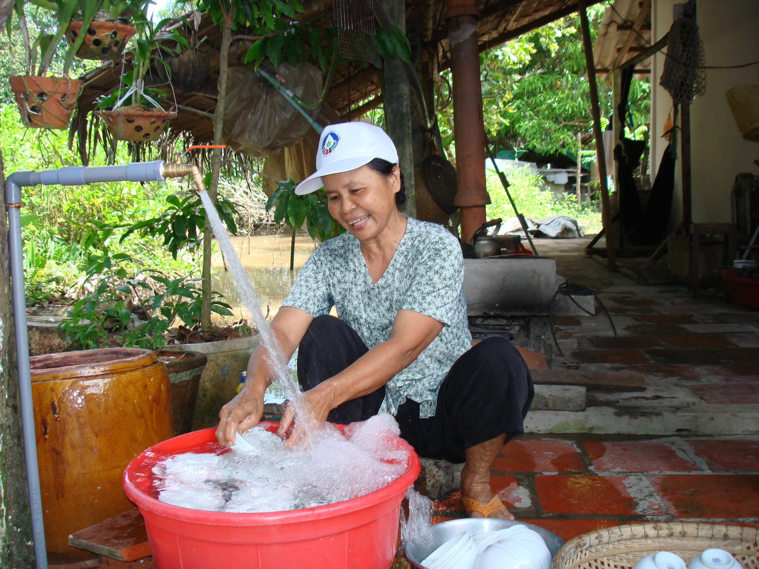 Clean running water in homes improves health and reduces work in Vietnam. Photo courtesy of Coffey International Development