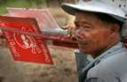 Signs warn people of landmines and other dangerous items in Cambodia.