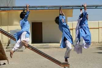 Play equipment is provided for active learning in Pakistan. Photo ©UNICEF/HQ06-0326/Pirozzi