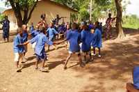 Grade 1 students in Sierra Leone singing 'This is the way we reconcile' from the Peace Education Kit.