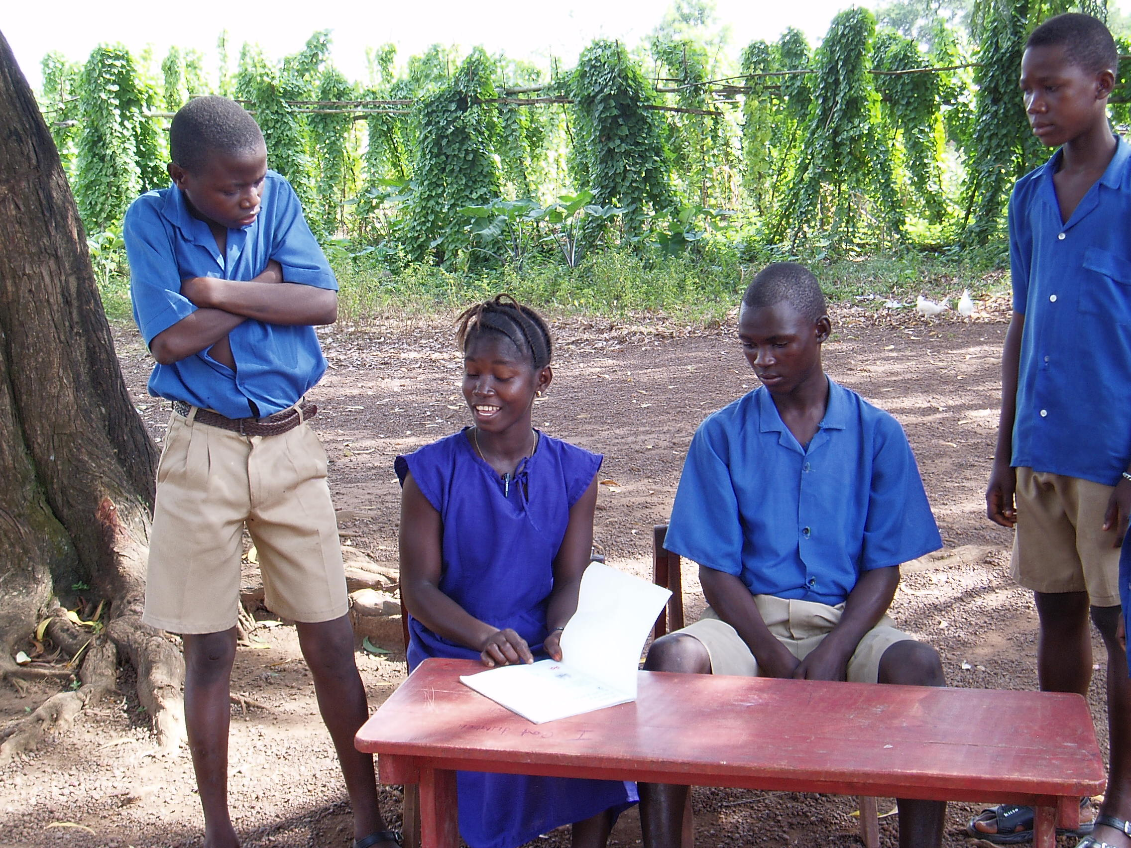 Year 8 and 9 students from Makeni Secondary School, Sierra Leone, performing a play they wrote about conflict resolution. Photo by Jane Weston