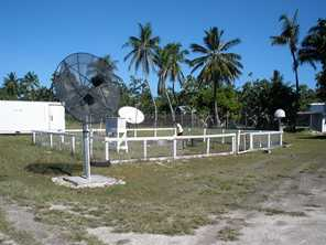 A weather-monitoring station in Kiribati has equipment for measuring wind speed and direction and temperature of air and sea. Photo by Jodi Gatfield for DFAT