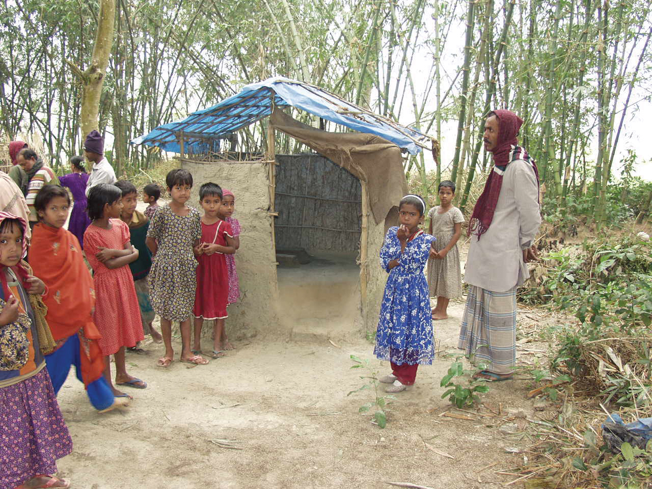 Mosmoil villagers built a sanitary latrine and worked together to stop open defecation. Photo by Shafiul Azam Ahmed for AusAID