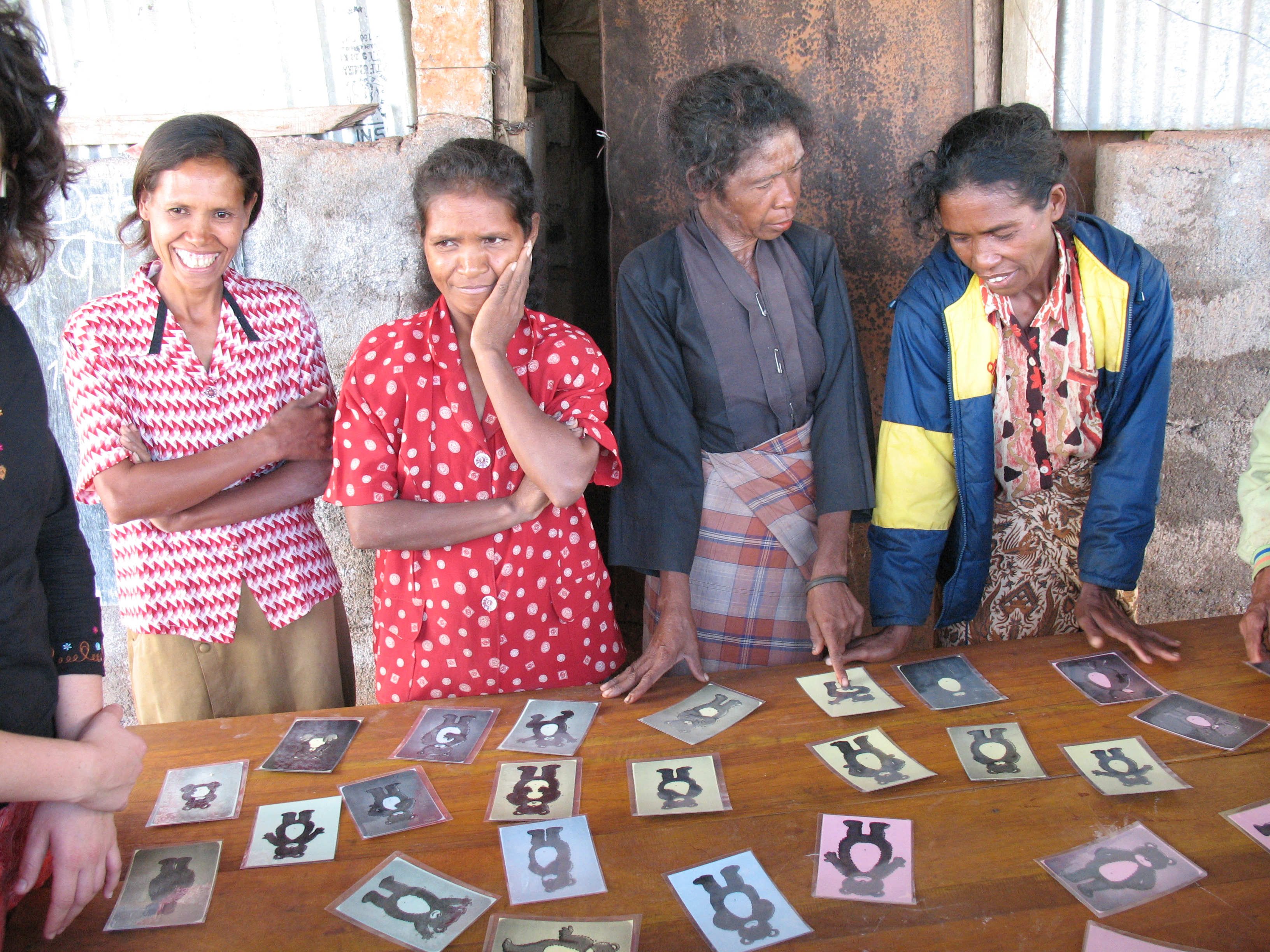 Village women develop learning materials in their local language to learn to read and write and overcome their disadvantage, in Timor-Leste. Photo by Erin McKinnon/IWDA
