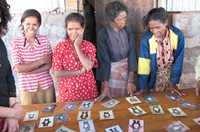 Village women develop learning materials in their local language to learn to read and write and overcome their disadvantage, in Timor-Leste.