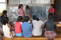 Village women experience new freedom through learning and talking together, in Timor-Leste.