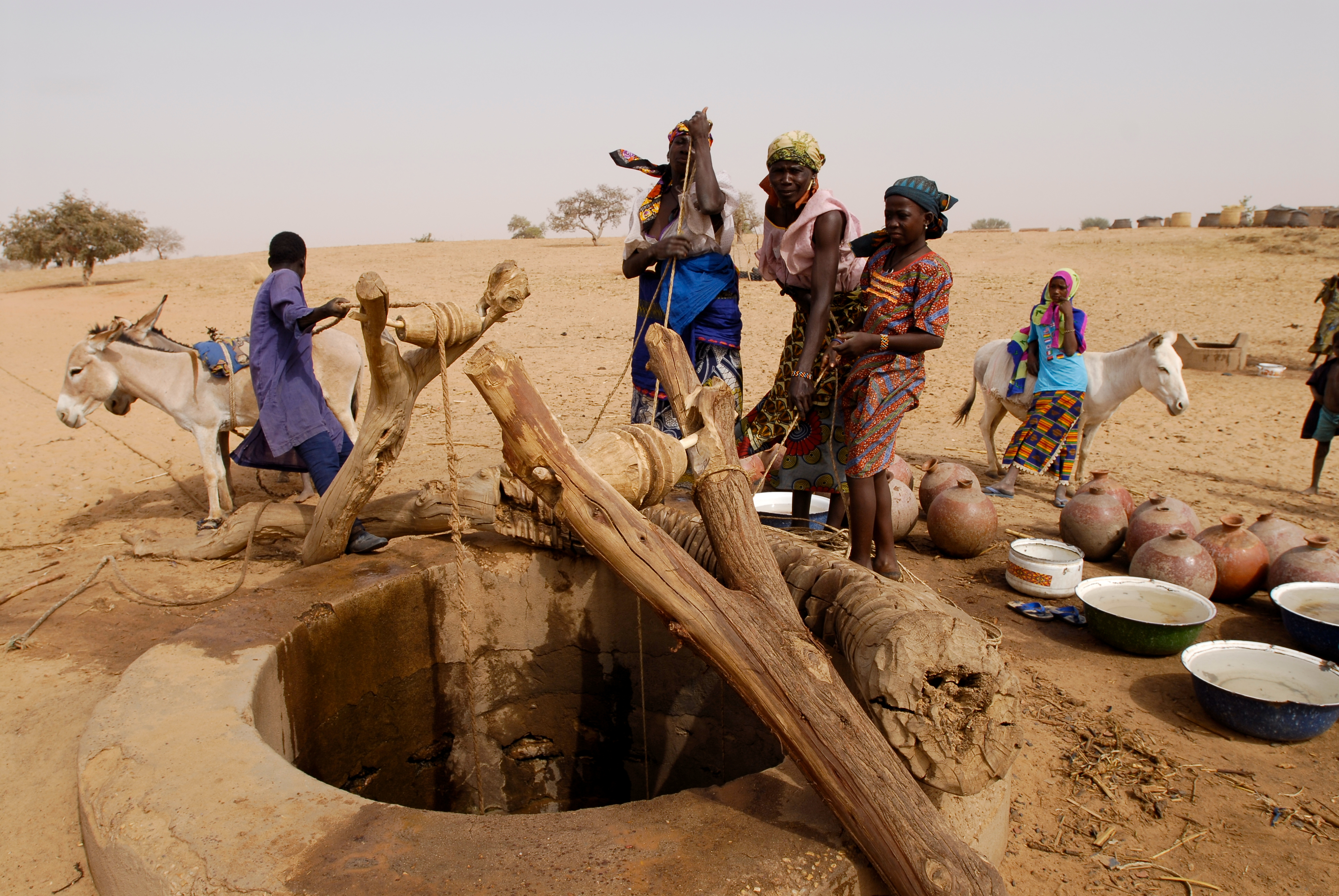 A simple wooden pulley reduces the effort needed to haul water from this well in Niger. Photo from World Vision Australia