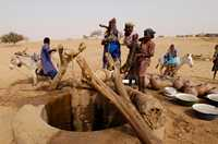 A simple wooden pulley reduces the effort needed to haul water from this well in Niger.