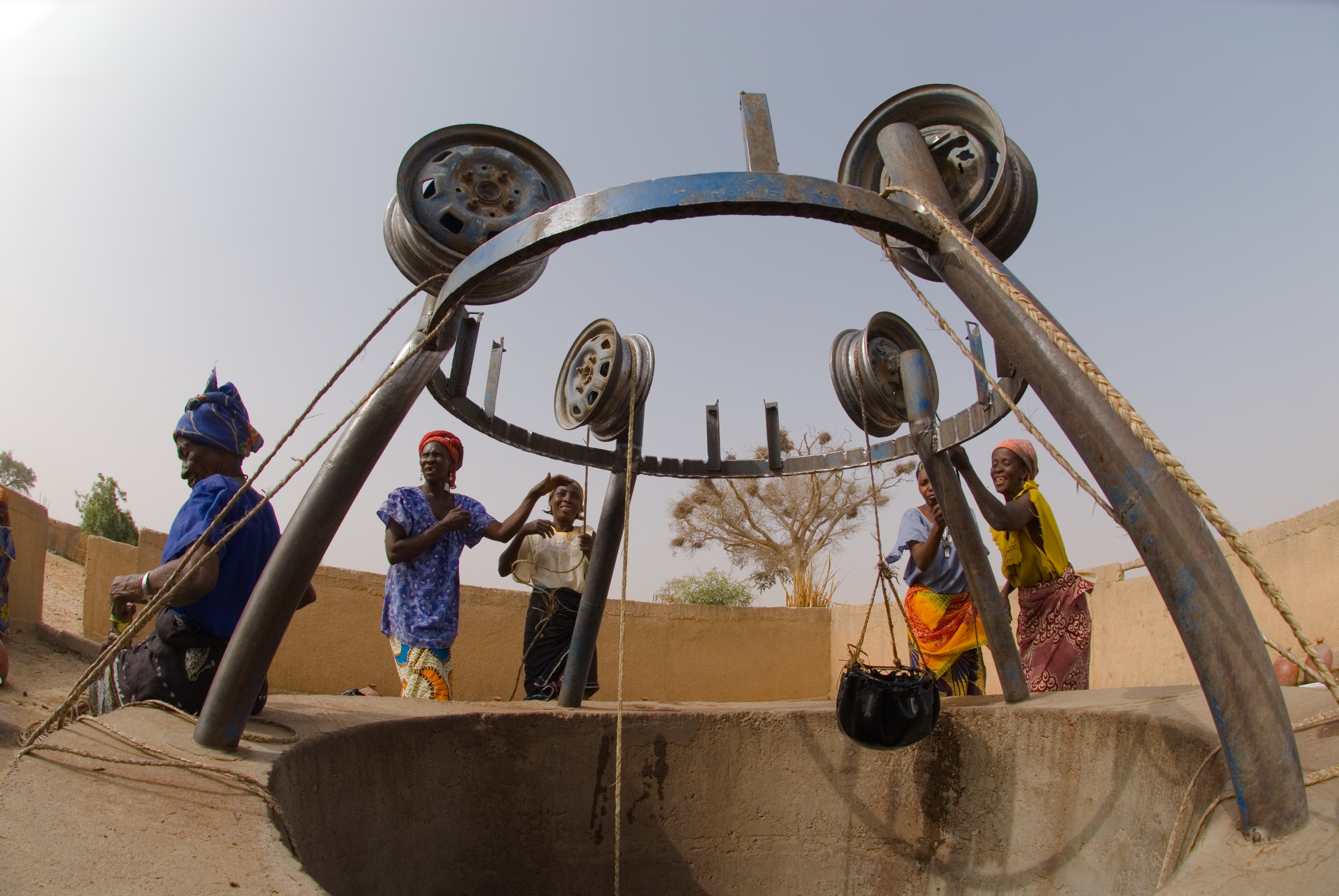 In Niger, this well and its surrounds have been sealed with concrete, and wheel hubs are mounted to act as pulleys. Photo from World Vision Australia