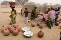 In Niger, villagers queue to use the new pump.