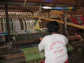 In Myanmar, the Longyi Weaving Project assists women living in refugee camps to maintain and develop traditional skills and earn an income. Photo from TBBC