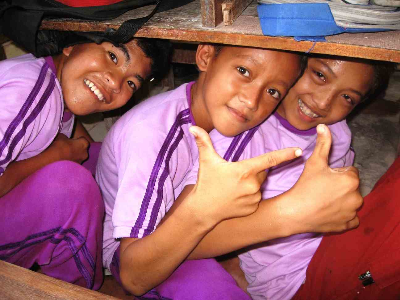 School children in Nias, Indonesia, are taught to get under tables and cover their heads after an earthquake. Photo © SurfAid