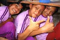 School children in Nias, Indonesia, are taught to get under tables and cover their heads after an earthquake.