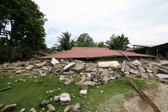 Most buildings were destroyed in the 2007 earthquake on the Mentawai Islands, but emergency preparation meant everyone was evacuated safely. Photo © SurfAid