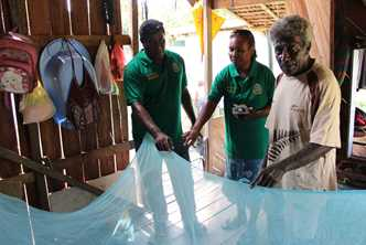 The Malaria Survey team checks houses for mosquito nets in Honiara, Solomon Islands. Photo by Jeremy Miller for AusAID