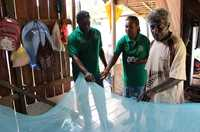 The Malaria Survey team checks houses for mosquito nets in Honiara, Solomon Islands.