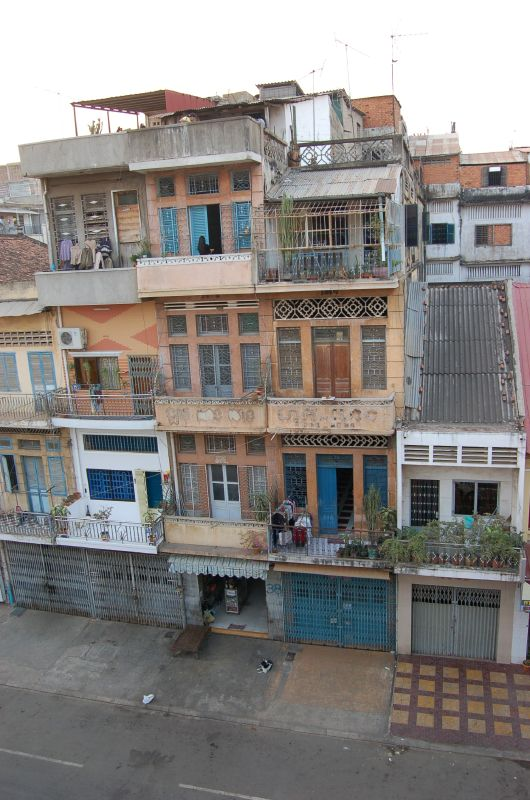 Apartments in Phnom Penh, Laos are built above a garage. They have electricity, running water and sewerage. Photo by Linny Heng / Flickr