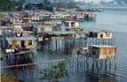 People who have moved to Port Moresby, Papua New Guinea, have built stilt houses over the water as they have no traditional land.