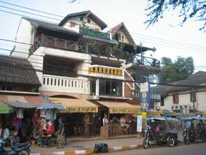 Apartments built above shops in Vientiane, Laos Photo by Prince Roy / Flickr http://creativecommons.org/licenses/by-nc-sa/2.0/