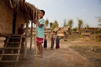 In rural villages in Laos, houses are built with walls of woven bamboo and have a grass thatched roof. AusAID