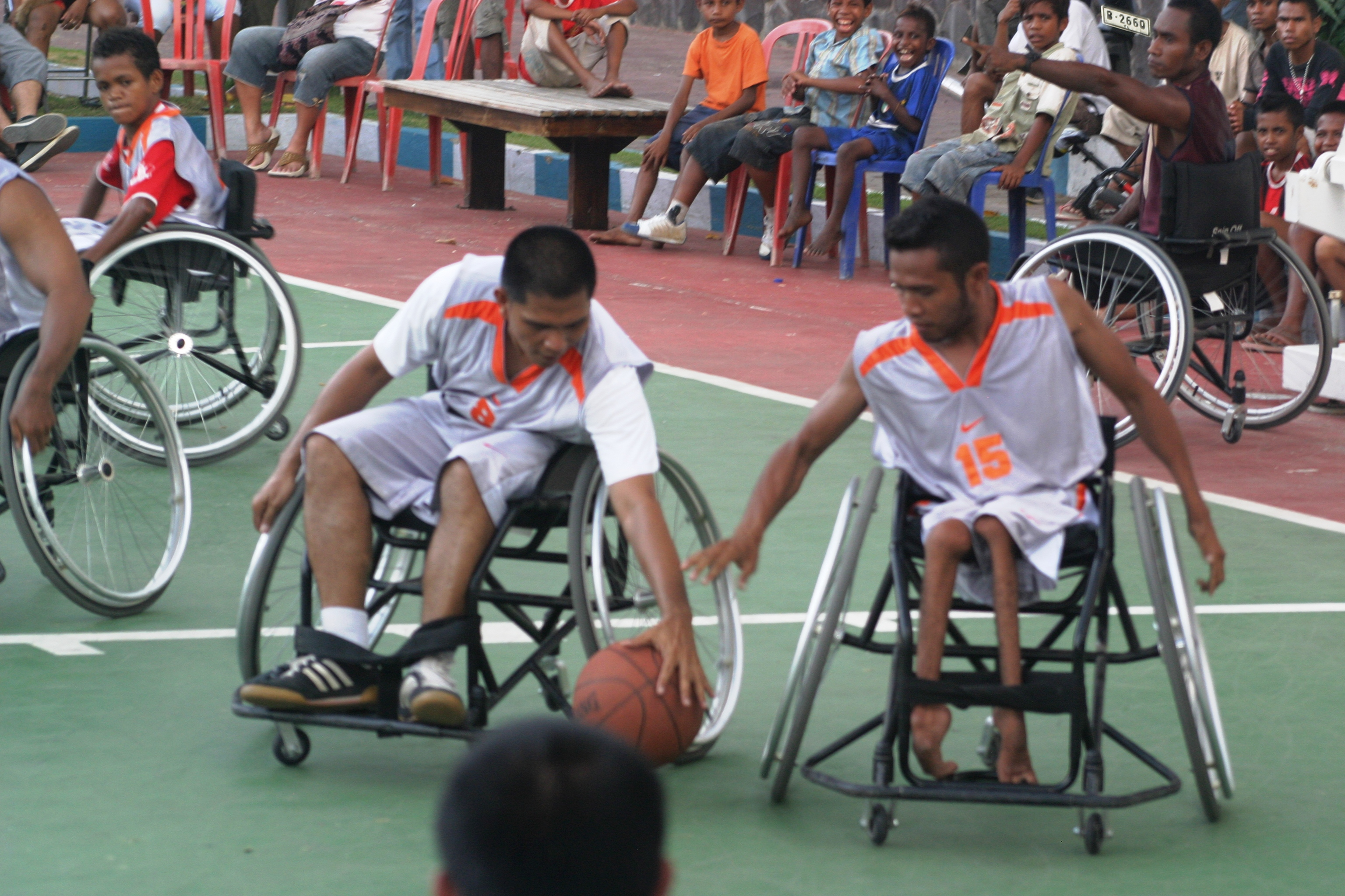 Young men with disabilities use specially designed wheelchairs to play basketball in Timor-Leste. Photo by Kathryn Outhred for DFAT